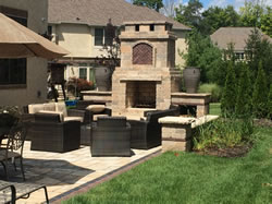 The outdoor living area with the paver patio and fire pit