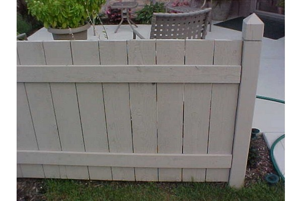 Light colored vinyl fencing.