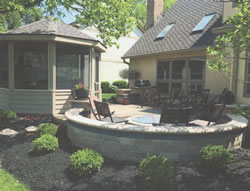 The gazebo on the left next to the Flagstone Patio and Fire Pit from a different angle